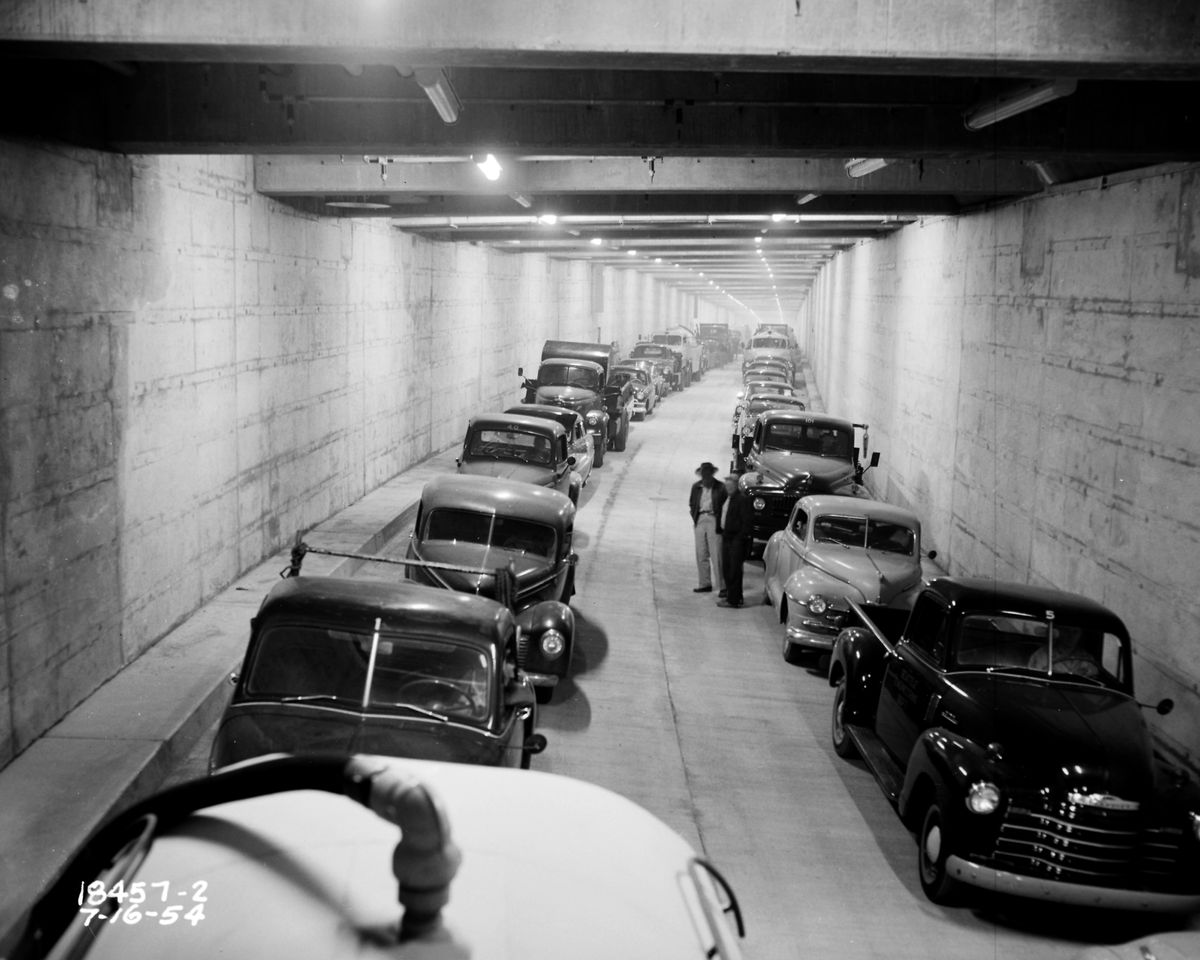 Cars lined up in the Battery Street Tunnel in Seattle. This is a black and white photograph.