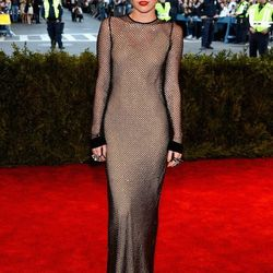 Miley Cyrus in fishnet Marc Jacobs. She did not have a problem following the dress code.