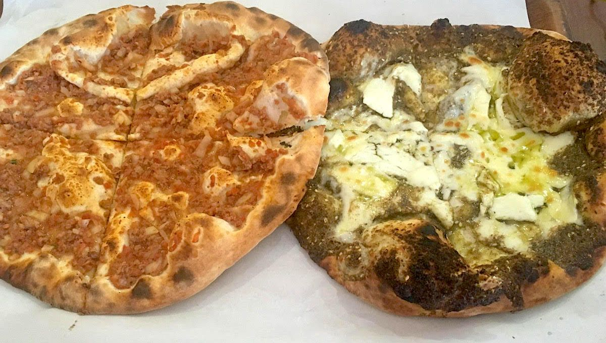Two man'oushe, one with zaatar and one with lamb, at Yasmina Restaurant in West Acton
