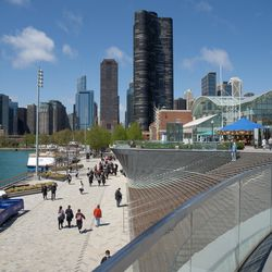 People walk around Navy Pier on its reopening day, Friday morning, April 30, 2021. Navy Pier was closed in 2020 due to the COVID-19 pandemic.