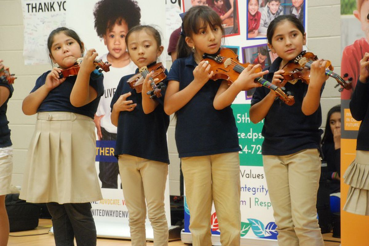Swansea Elementary students play violins before the grant was announced.