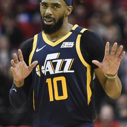 Utah Jazz guard Mike Conley reacts after making a three point basket during the second half of an NBA basketball game against the Houston Rockets, Sunday, Feb. 9, 2020, in Houston.
