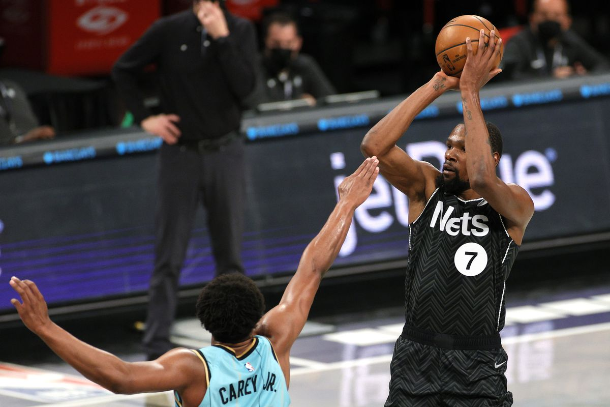 Kevin Durant of the Brooklyn Nets shoots as Vernon Carey Jr. of the Charlotte Hornets defends during the first half at Barclays Center on April 16, 2021 in the Brooklyn borough of New York City.