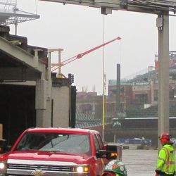 A large crane is operating within the playing field, on this day its main job was lifting