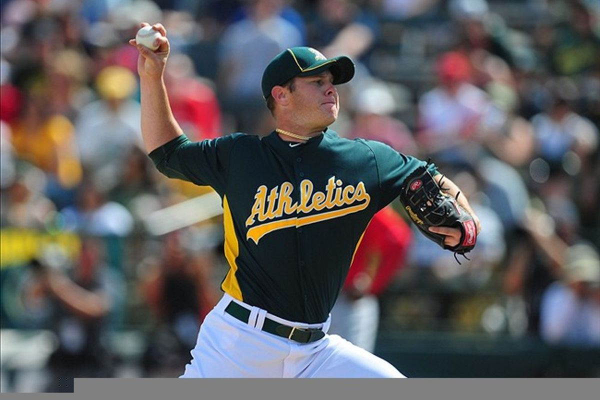 Mar. 4, 2012; Phoenix, AZ, USA; Oakland Athletics pitcher Brad Peacock pitches in the first inning against the Los Angeles Angels during a spring training game at Phoenix Municipal Stadium.  Mandatory Credit: Mark J. Rebilas-US PRESSWIRE