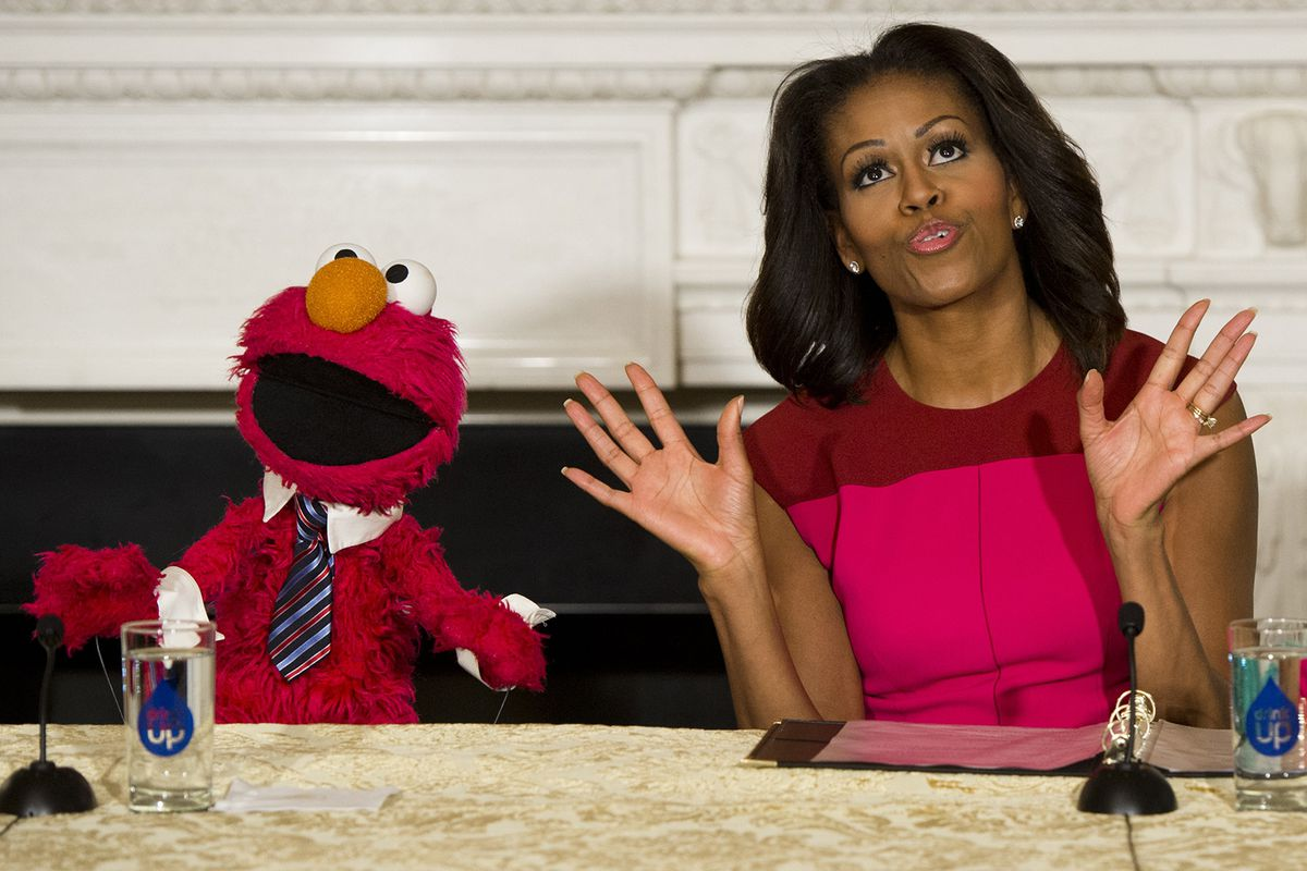Michelle Obama with a puppet.