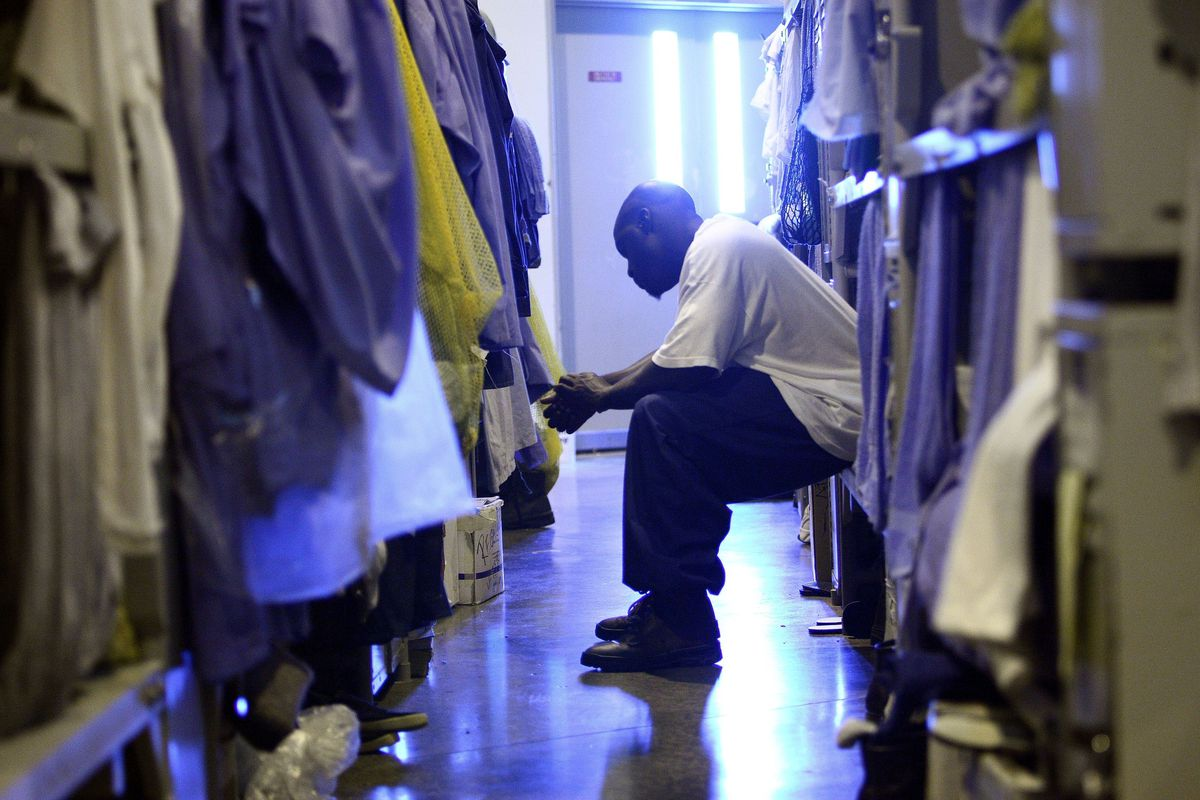 An inmate sits at a California prison.