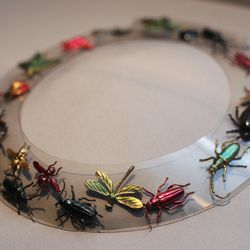 This is the only known, surviving example of Elsa Schiaparelli's bug necklace