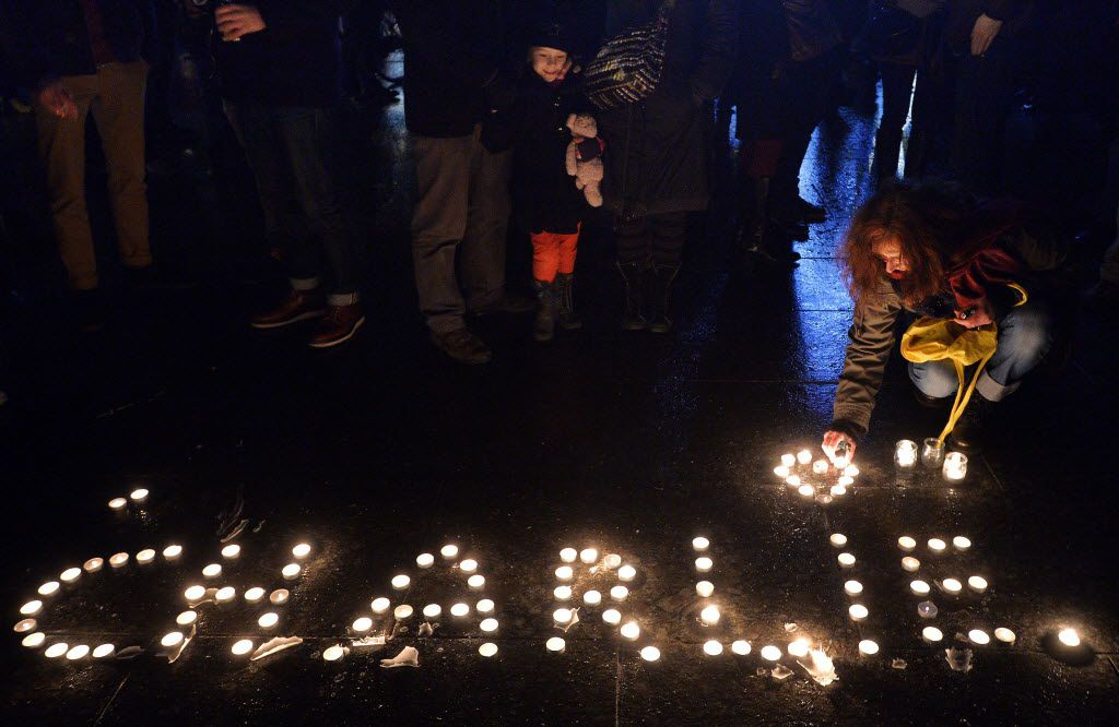 <small><strong>People light candles forming the name Charlie during a gathering in Strasbourg, France. | Getty Images</strong></small>