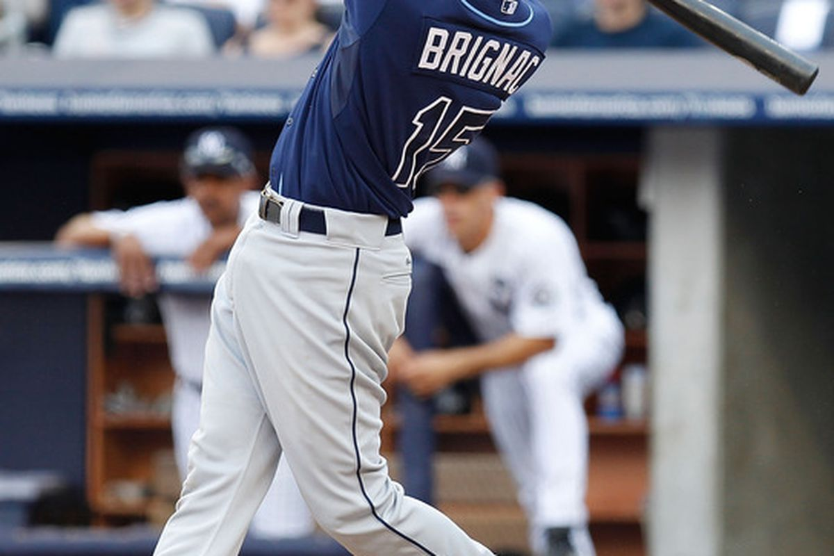 NEW YORK - JULY 17:  Reid Brignac #15 of the Tampa Bay Rays hits his second home run of the game against the New York Yankees on July 17 2010 at Yankee Stadium in the Bronx borough of New York City.  (Photo by Mike Stobe/Getty Images)