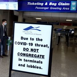 """The security line is empty at the Salt Lake City International Airport on Wednesday, April 8, 2020. Utah Gov. Gary Herbert announced new efforts on Wednesday """"to protect the people of Utah and slow the spread of coronavirus in the state"""" by closely monitoring its borders, as well as passengers who fly into the airport."""