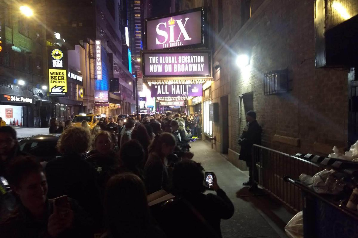 """Theatergoers wait to see """"Six"""" at the Brooks Atkinson Theatre on Feb. 23, 2020."""