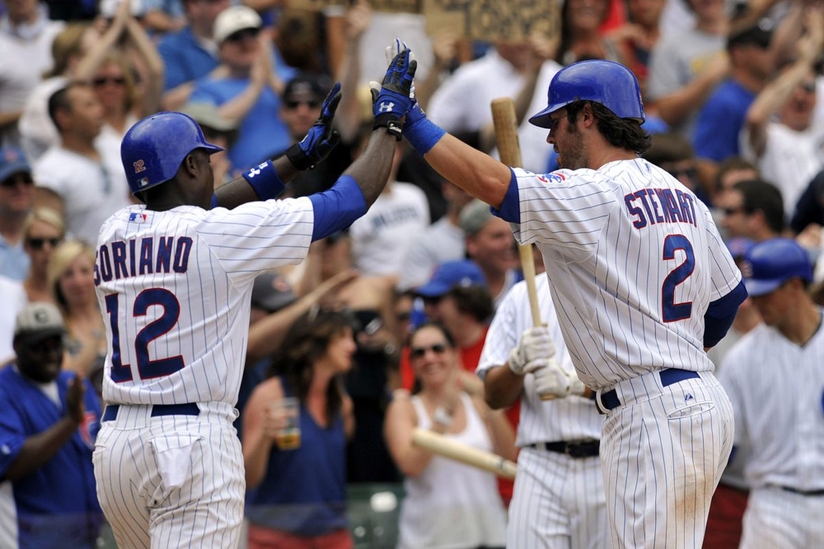 Ian Stewart of the Chicago Cubs gets congratulated by Alfonso Soriano after hitting a two-run homer against the San Diego Padres at Wrigley Field in Chicago, Illinois.  (Photo by David Banks/Getty Images)