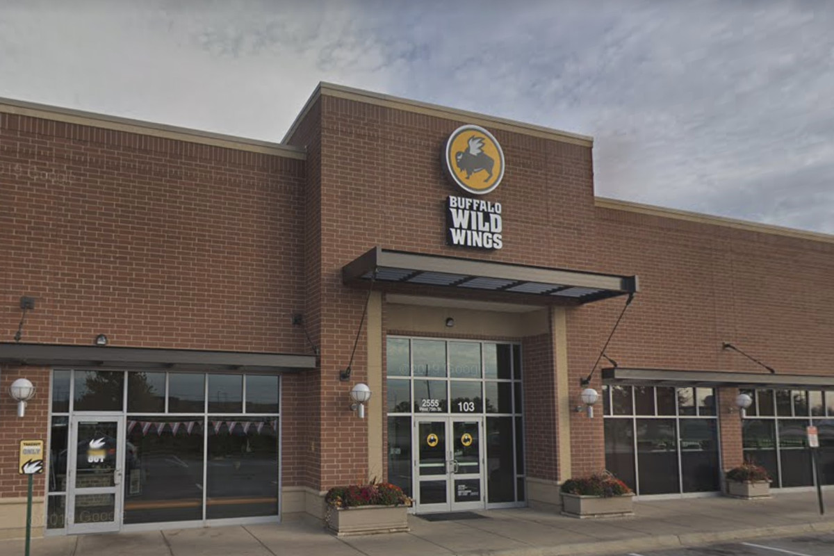 """A large brick building with a sign that reads """"Buffalo Wild Wings"""""""