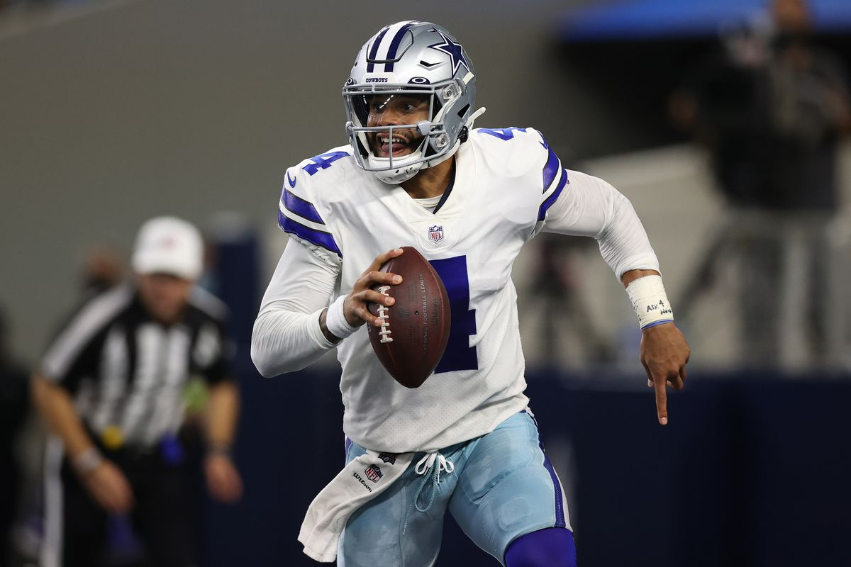 Dak Prescott of the Dallas Cowboys looks for a open receiver in the first half while playing the Philadelphia Eagles at AT&T Stadium on September 27, 2021 in Arlington, Texas.