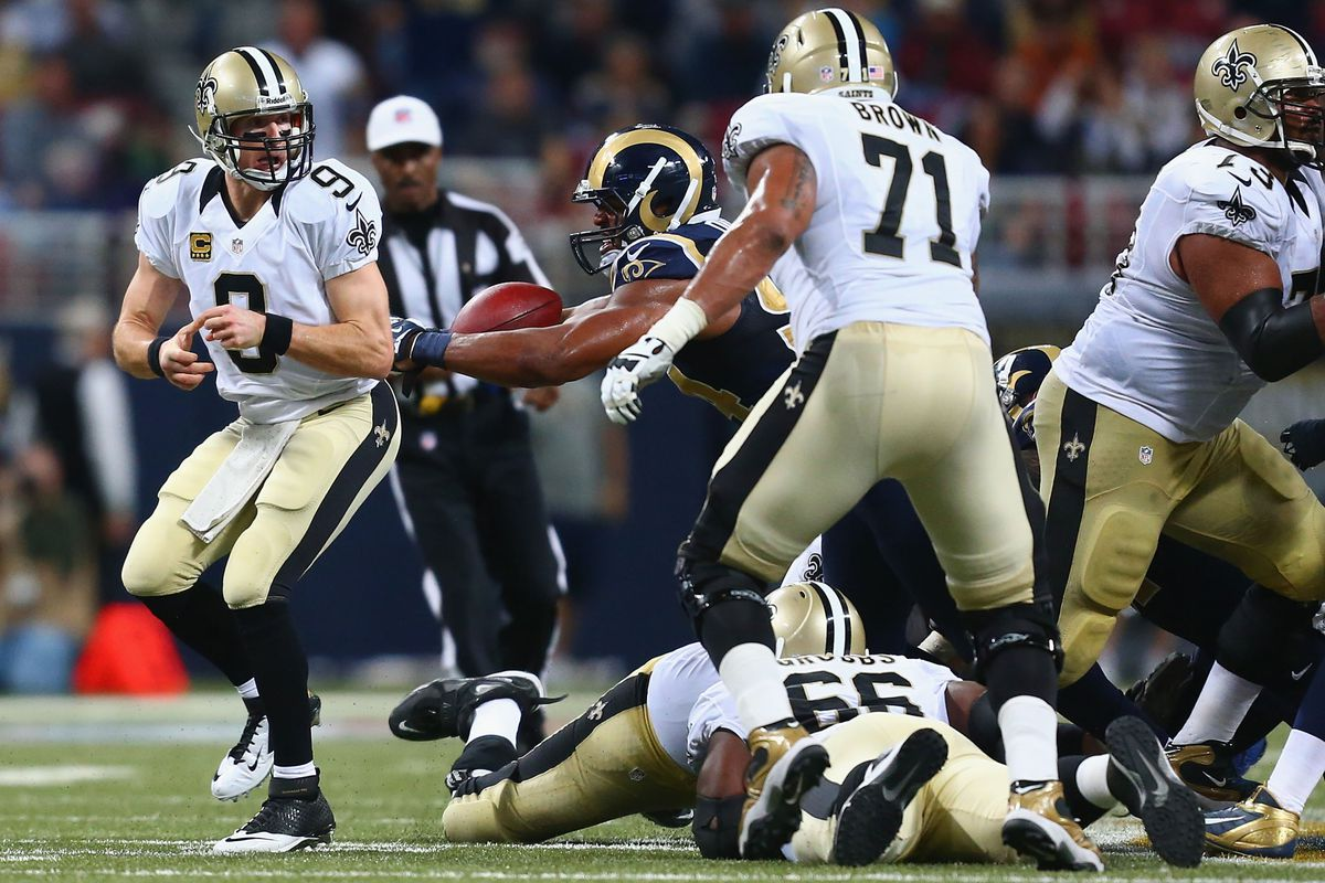 Robert Quinn beats Charles Brown and strips the ball from Drew Brees.