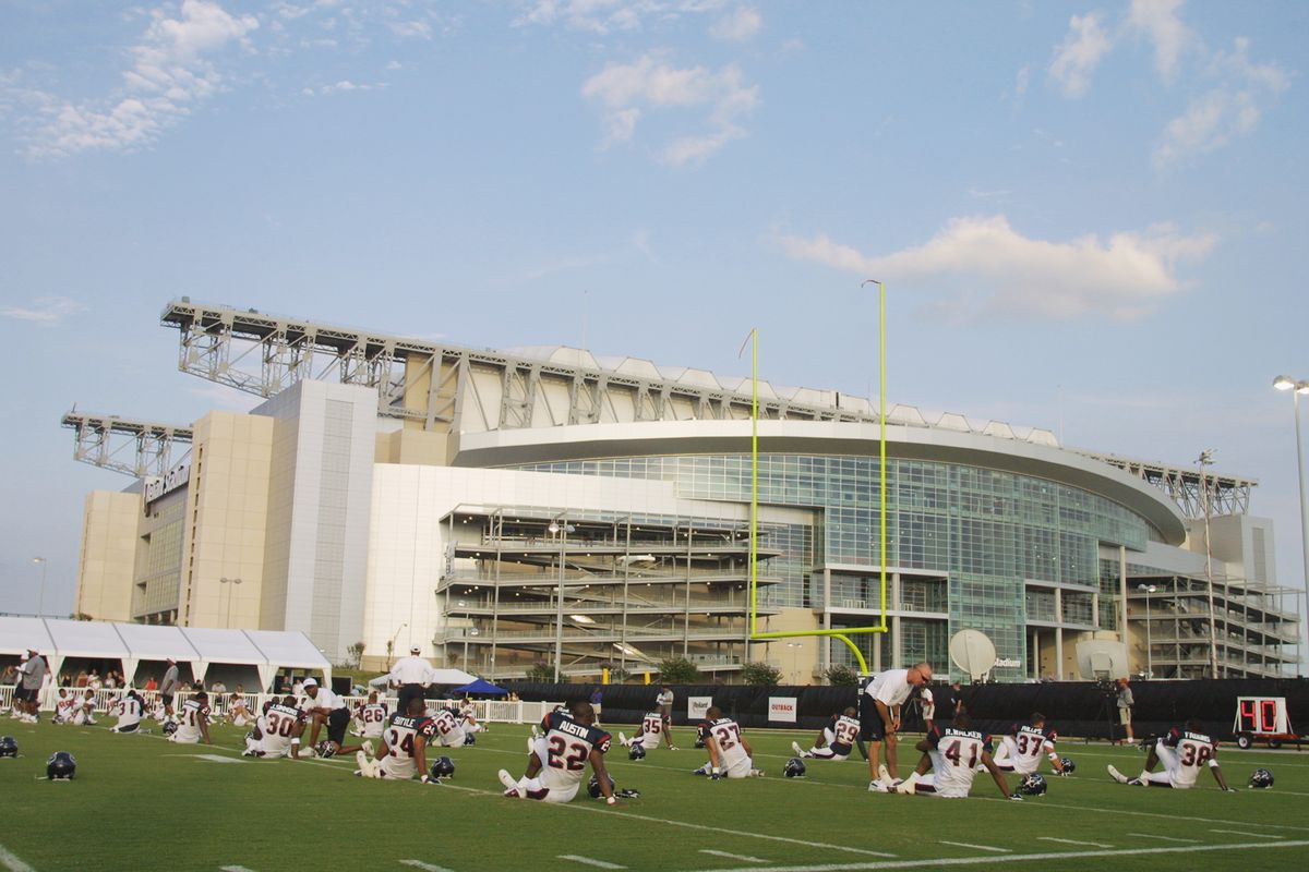 The Texans work out in front of Reliant Stadium