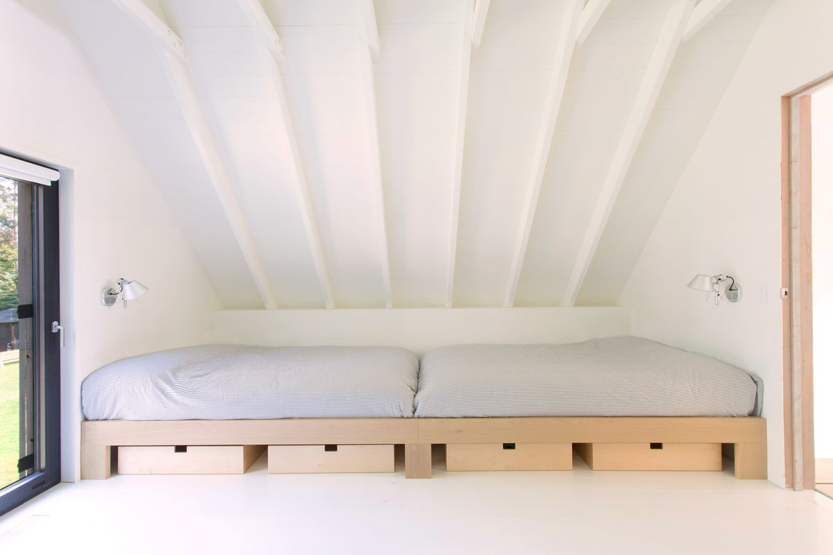 Bedroom with bed and white walls