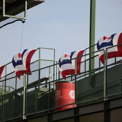 3:56 p.m. The bunting in the left field bleachers catching the wind, like a sail -