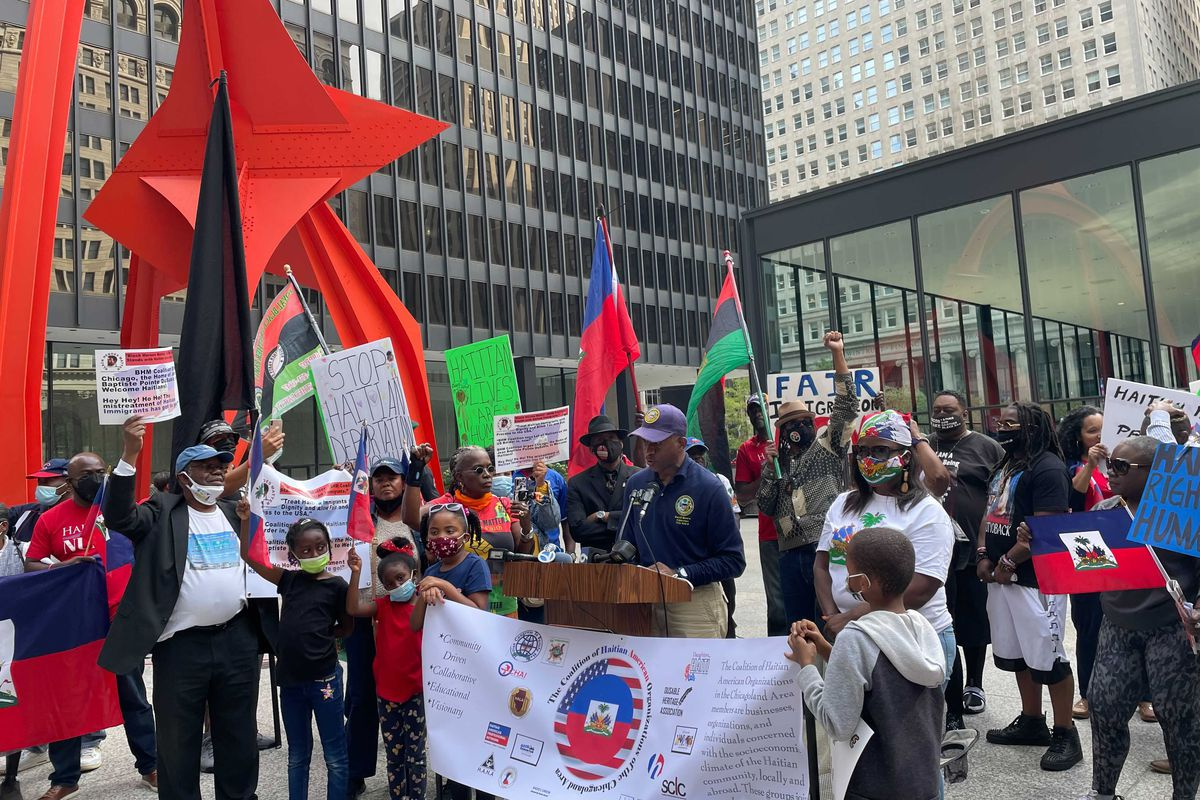 Ald. David Moore (17th) speaks to the crowd at a rally organized by a coalition of Haitian-American organizations in the Chicago area.
