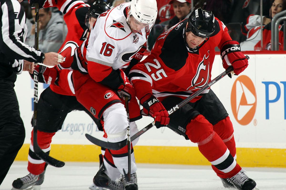NEWARK NJ - FEBRUARY 16: Brandon Sutter #16 of the Carolina Hurricanes and Jason Arnott #25 of the New Jersey Devils battle for the puck at the Prudential Center on February 16 2011 in Newark New Jersey.  (Photo by Bruce Bennett/Getty Images)