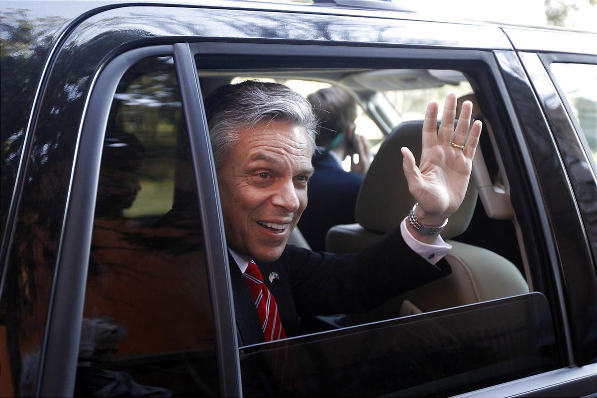 Republican presidential candidate former Utah Gov. Jon Huntsman waves as he is driven away from a campaign stop, Sunday, Jan. 15, 2012, in Charleston, S.C.