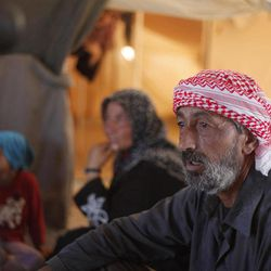 In this Tuesday, Sept. 11, 2012 photo, Ghassan Baradan, 50, a farmer who fled his southern restive border town of Daraa, Syria with his family in July, speaks during an interview at the Zaatari Refugee Camp, in Mafraq, Jordan. Jordan now hosts 200,000 Syrians, the largest number of refugees of any neighboring country. After months of delay, Jordan finally opened its first official refugee camp in July at Zaatari, near the border with Syria.