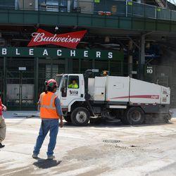 2:23 p.m. Street-sweeping truck working outside the main bleacher gate -