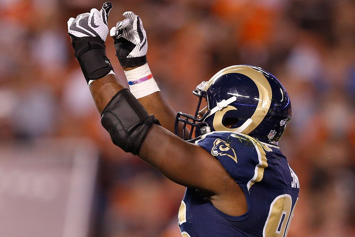 Michael Sam reacts after sacking Johnny Manziel in the preseason