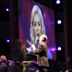 Image of guest artist Katherine Jenkins is displayed on giant screen in LDS Conference Center as associate music director Ryan Murphy conducts Mormon Tabernacle Choir and Orchestra at Temple Square during July 19, 2012 dress rehearsal for Pioneer Day Concert.