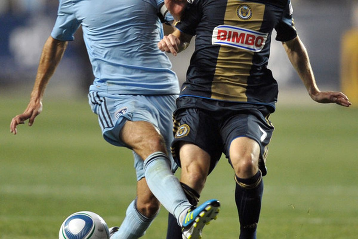 CHESTER, PA - JUNE 22: Davy Arnaud #22 of Sporting Kansas City and Brian Carroll #7 of the Philadelphia Union fight for the ball during at PPL Park on June 22, 2011 in Chester, Pennsylvania. The game ended 0-0. (Photo by Drew Hallowell/Getty Images)
