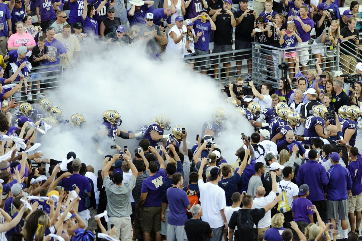 Dawg fans and players celebrate legalized marijuana at the grand re-opening of Husky Stadium