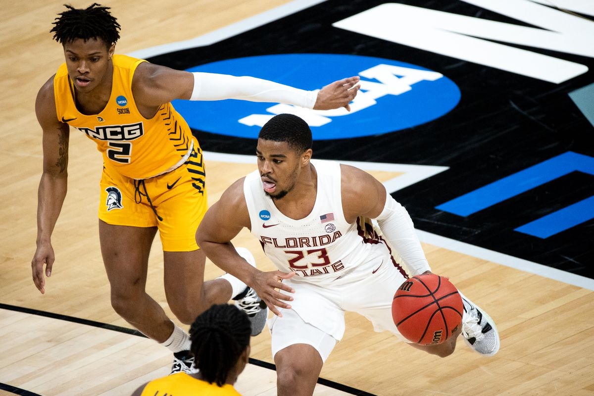 Florida State guard MJ Walker drives the ball as UNC Greensboro guard AJ McGinnis follows during the first round of the 2021 NCAA Tournament on Saturday, March 20, 2021, at Bankers Life Fieldhouse in Indianapolis, Ind.