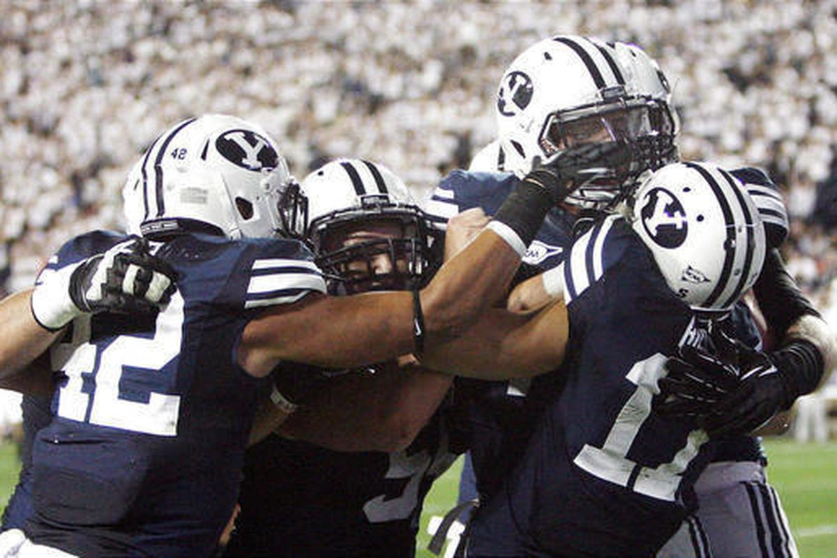 Brigham Young Cougars wide receiver Skyler Ridley (17) celebrates his touchdown with teammates against Washington State in Provo Thursday, Aug. 30, 2012.