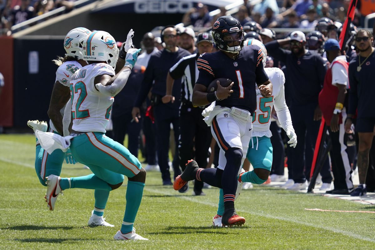 Bears rookie quarterback Justin Fields (1) completed 14-of-20 passes for 142 yards, one touchdown and no interceptions in his preseason debut Saturday at Soldier Field. He also scored on an eight-yard run.
