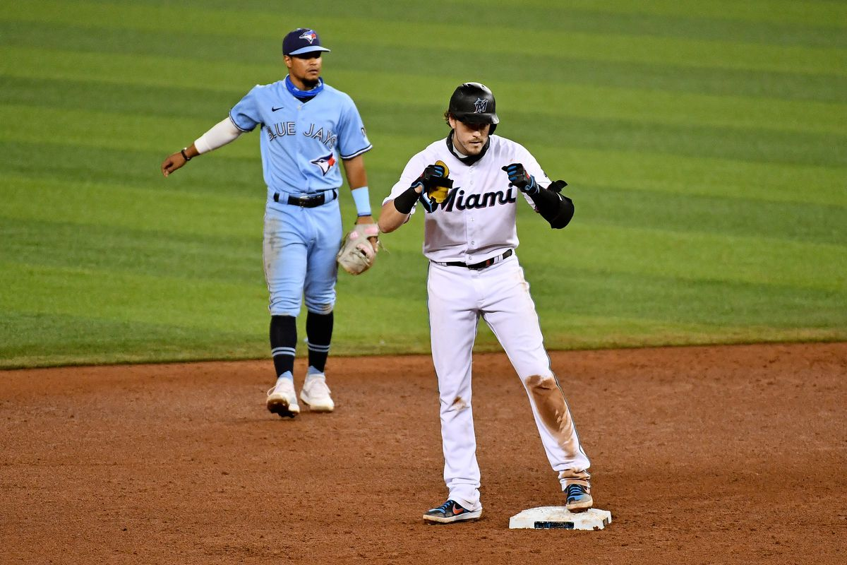 Miami Marlins third baseman Brian Anderson (15) stands at second base after hitting a double in the 6th inning against the Toronto Blue Jays at Marlins Park.