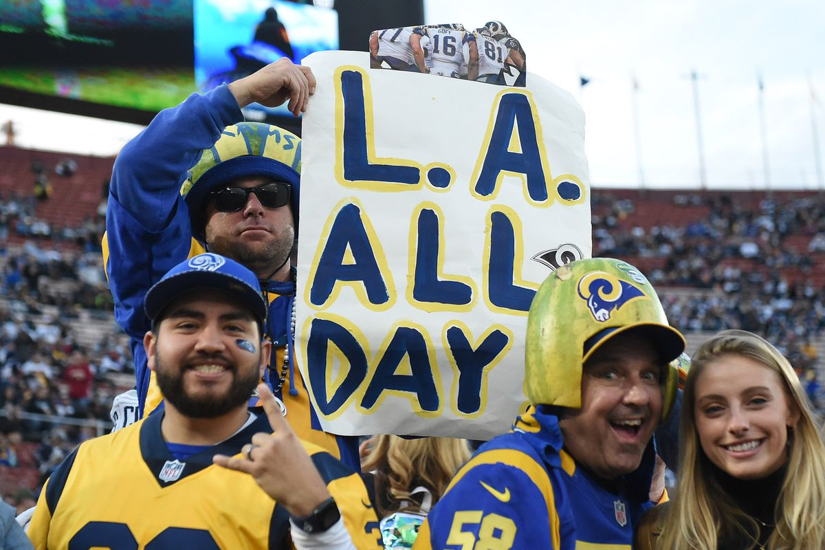 Los Angeles Rams fans cheer before the NFC Divisional playoff football game against the Dallas Cowboys at the Los Angeles Memorial Coliseum, Jan. 12, 2019.