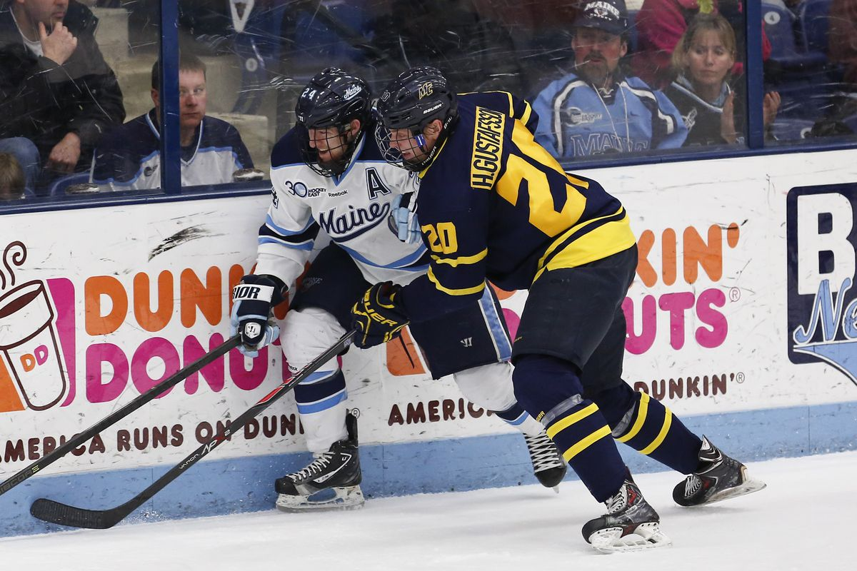 Hampus Gustafsson battles for a loose puck in last season's Hockey East Tournament game at Maine.