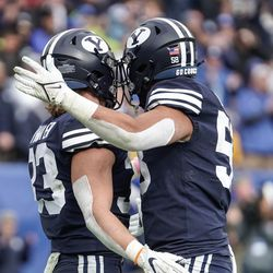 BYU linebacker Ben Bywater, left, and defensive lineman Uriah Leiataua celebrate during an NCAA college football game against Boise State at LaVell Edwards Stadium in Provo on Saturday, Oct. 9, 2021.