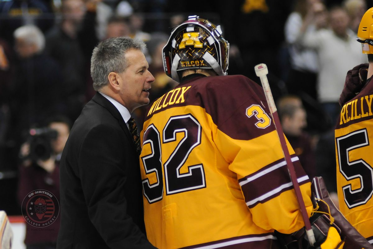 Minnesota head coach Don Lucia (far left) speaking with goalie Adam Wilcox during his team's 4-0 win over St. Cloud State (D Mike Reilly far right)