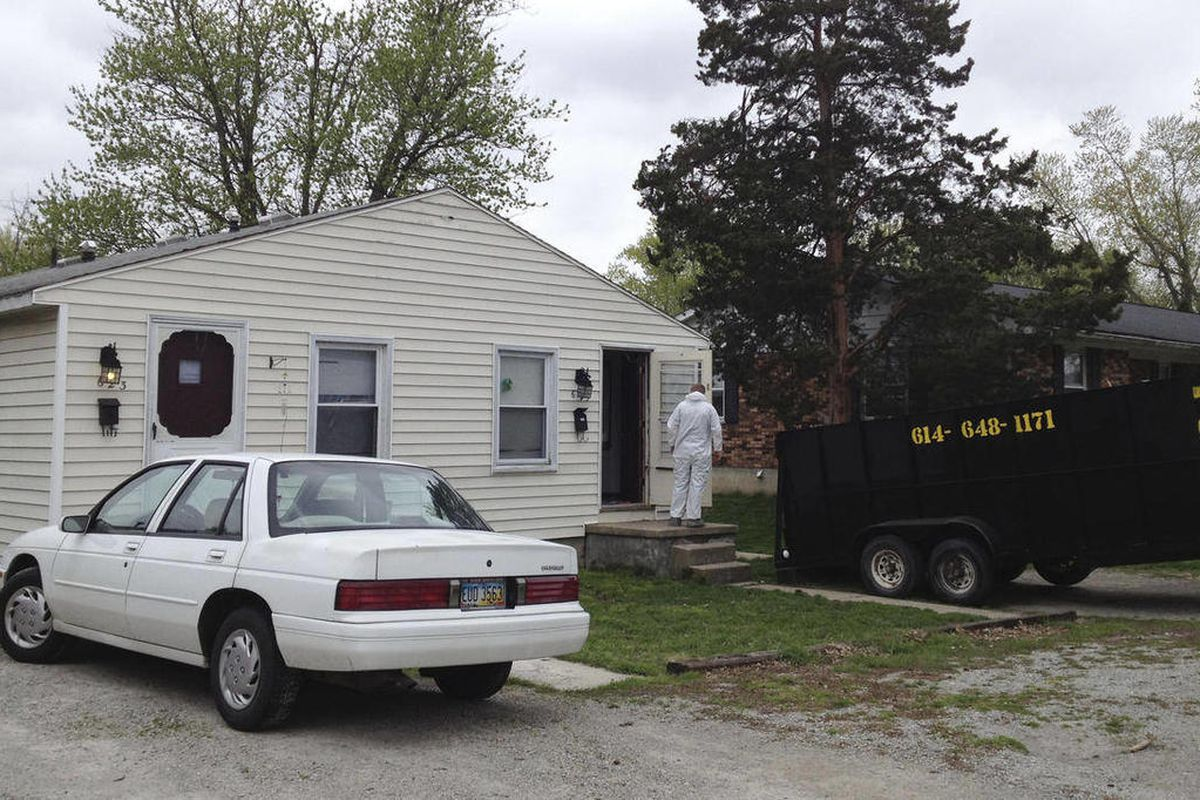 Workers clean out a home Tuesday, April 3, 2012 where 21-year-old Jessica Rae Sacco was killed Friday in Urbana, Ohio. A $100,000 bond has been set for 25-year-old Matthew Puccio, who is accused of stabbing and suffocating Sacco, then dismembering her bod
