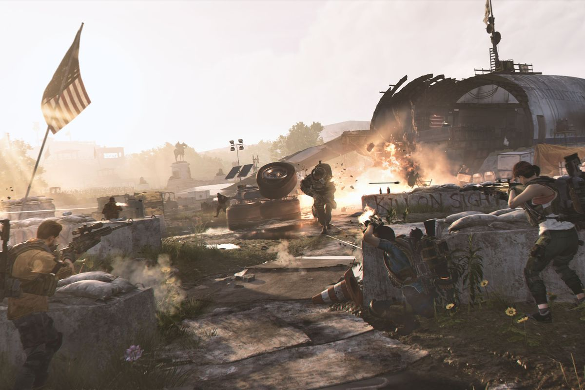 A group of players fire on a heavily armored enemy near a downed Air Force One in a screenshot from Ubisoft's The Division 2.
