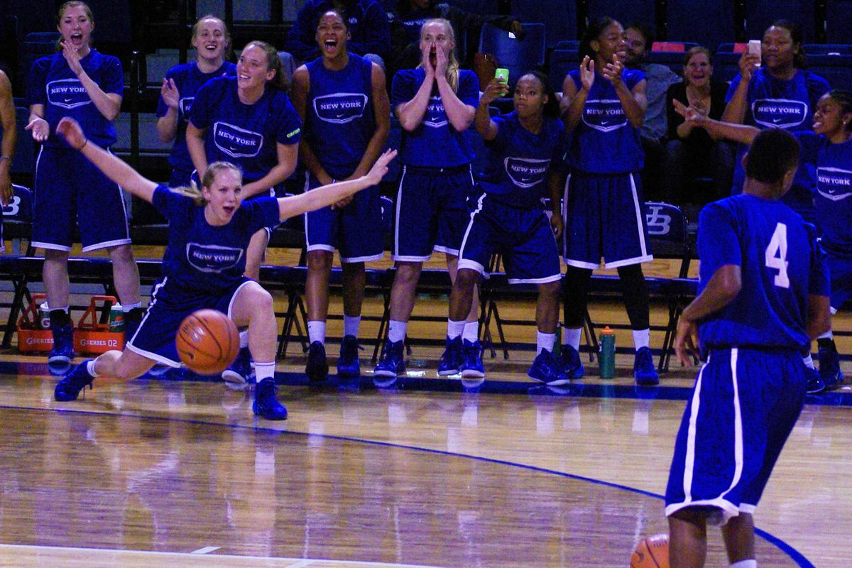 Mackenzie Loesing and the Buffalo bench celebrate Joanna Smith's performance in the three-point shooting contest at Bulls Madness Friday.