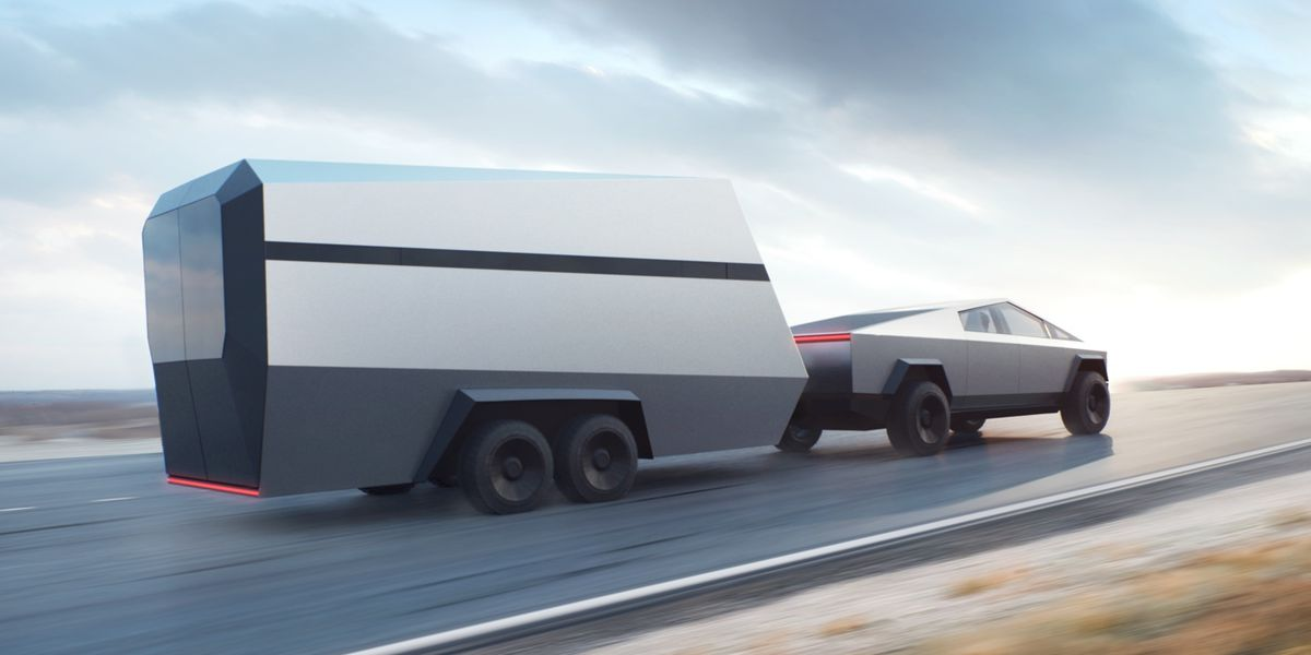 A futuristic silver truck pulls a boxy, silver travel trailer down a highway.