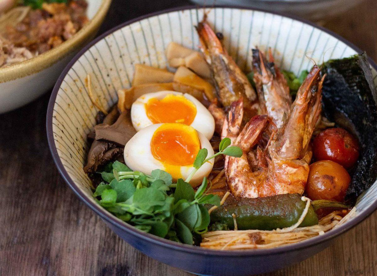 A bowl of Filipino-Japanese ramen with prawns and an egg at Ramo Ramen Kentish Town