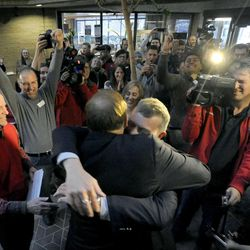 The crowd cheers after Salt Lake City Mayor Ralph Becker married state Sen. Jim Debakis and Stephen Justesen in the Salt Lake County offices after a federal judge ruled that Amendment 3, Utah's same-sex marriage ban, is unconstitutional on Friday, Dec. 20, 2013.