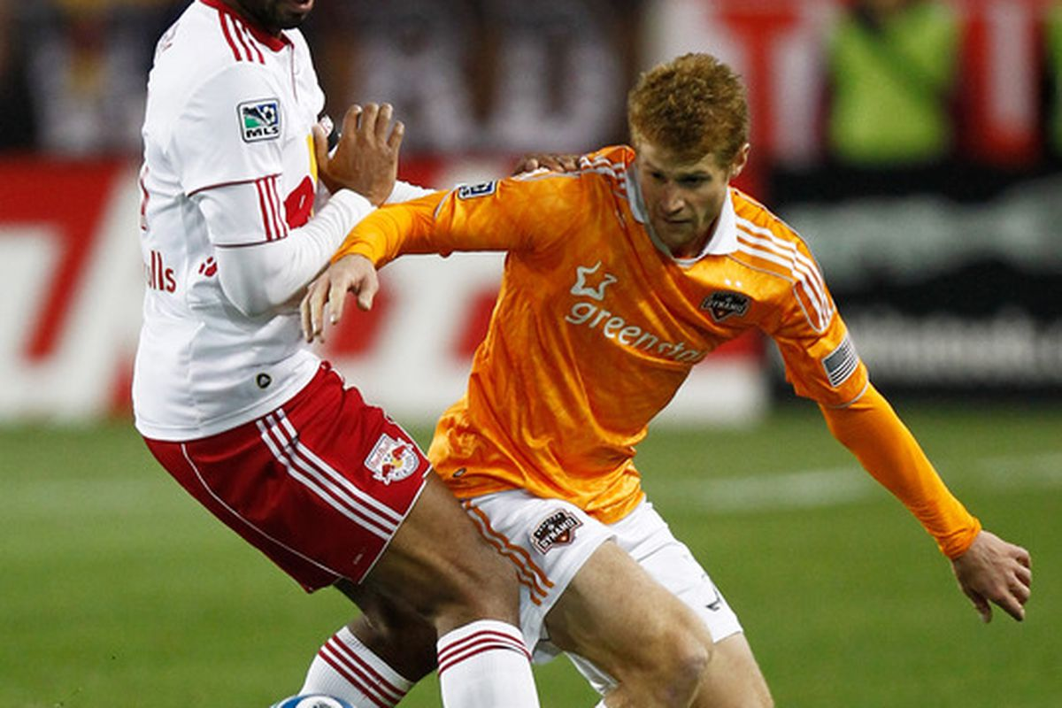 HARRISON, NJ - APRIL 02: Andrew Hainault #31 of the Houston Dynamo controls the ball against Thierry Henry #14 of the New York Red Bulls at Red Bull Arena on April 2, 2011 in Harrison, New Jersey.  (Photo by Jeff Zelevansky/Getty Images)