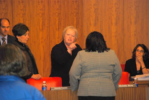 Michelle Moss confronts Andrea Merida before Monday's school board meeting.