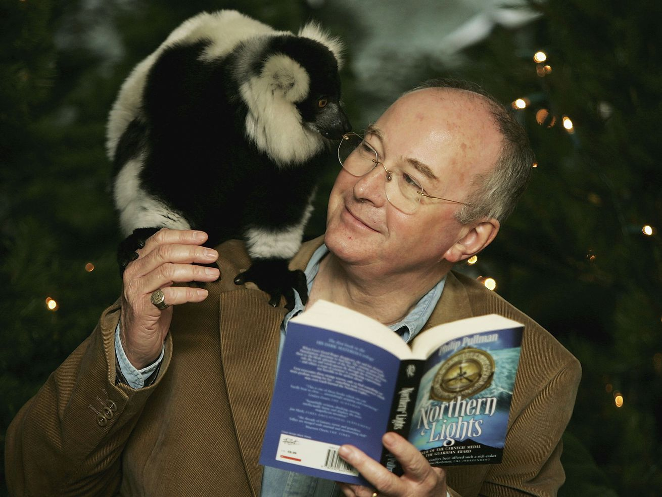 Philip Pullman with an animal at London Zoo. Does the animal have the pen? Could be!