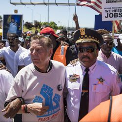 The Rev. Michael Pfleger and CPD Supt. Eddie Johnson march arm-in-arm.   Ashlee Rezin/Sun-Times